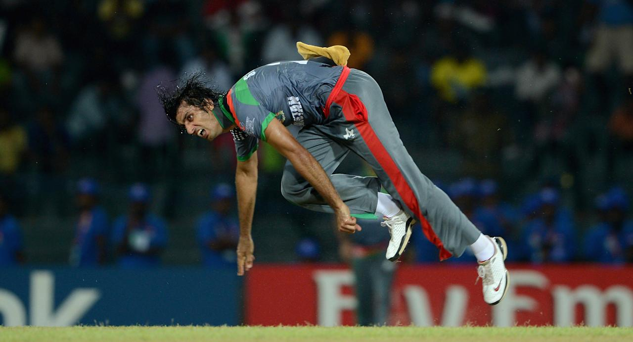 COLOMBO, SRI LANKA - SEPTEMBER 19:  Shapoor Zadran of Afghanistan bowls during the  ICC World Twenty20 2012: Group A match between India and Afghanistan at R. Premadasa Stadium on September 19, 2012 in Colombo, Sri Lanka.  (Photo by Gareth Copley/Getty Images,)