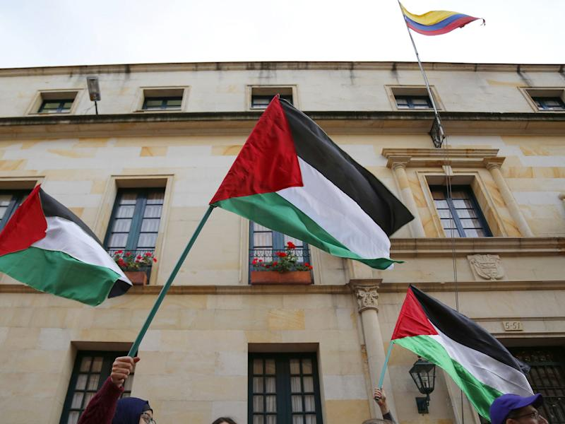 Demonstrators wave Palestinian flags during a protest outside the Foreign Ministry in Bogota: JOHN VIZCAINO/AFP/Getty Images