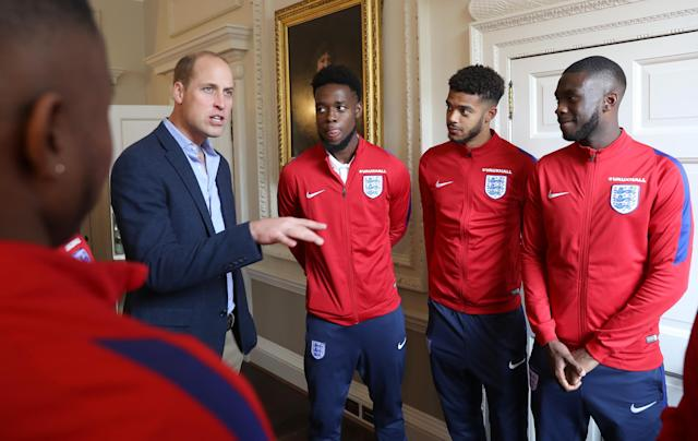 LONDON, ENGLAND - SEPTEMBER 07: Prince William, Duke of Cambridge (L) President of the Football Association, speaks with Josh Onomah, Jake Clarke-Salter and Fikayo Tomori during a reception for the Under-20 England Football Team at Kensington Palace on September 7, 2017 in London, England. The England Under-20 side became the first England team to win a football World Cup since 1996 when they beat Venezuela 1-0 on June 11th, 2017. (Photo by Chris Jackson - WPA Pool/Getty Images)