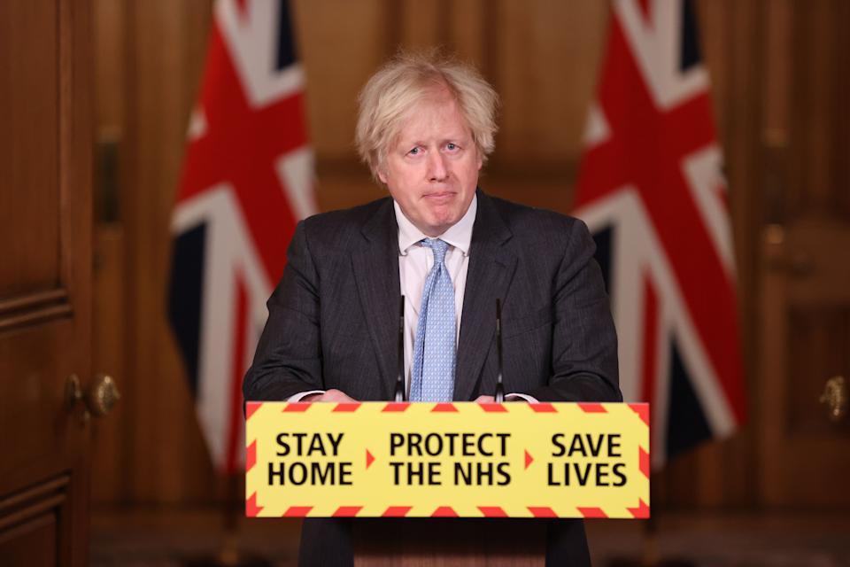Britain's Prime Minister Boris Johnson speaks during a virtual press conference inside 10 Downing Street in central London on February 10, 2021, to give an update on the coronavirus covid-19 pandemic. - The United Kingdom is one of the worst affected countries with almost 115,000 deaths from the virus, while authorities hope that the peak has passed. (Photo by Steve Reigate / POOL / AFP) (Photo by STEVE REIGATE/POOL/AFP via Getty Images)