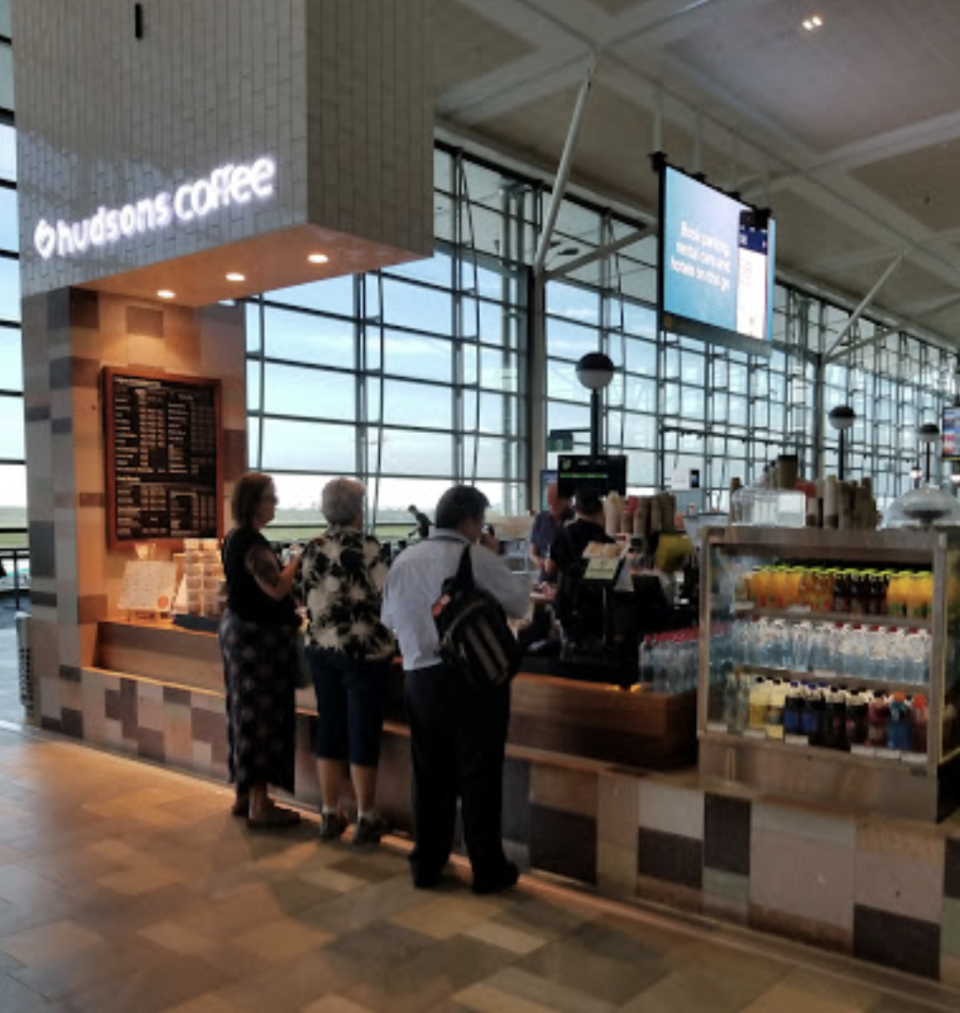One of the airport's Hudsons Coffee outlets was listed as a potential exposure site. Source: Google Maps