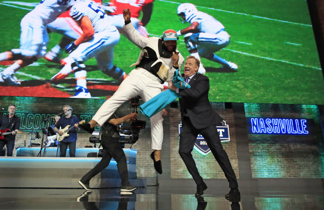 """Christian Wilkins of Clemson celebrates with NFL Commissioner Roger Goodell after being chosen No. 13 overall by the <a class=""""link rapid-noclick-resp"""" href=""""/nfl/teams/miami/"""" data-ylk=""""slk:Miami Dolphins"""">Miami Dolphins</a> during the first round of the 2019 NFL draft. (Photo by Andy Lyons/Getty Images)"""
