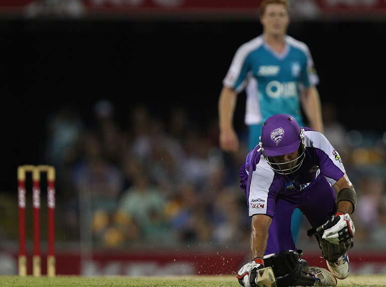BRISBANE, AUSTRALIA - JANUARY 06:  Owais Shah of the Hurricanes dives for the crease during the T20 Big Bash League match between the Brisbane Heat and the Hobart Hurricanes at The Gabba on January 6, 2012 in Brisbane, Australia.  (Photo by Chris Hyde/Getty Images)