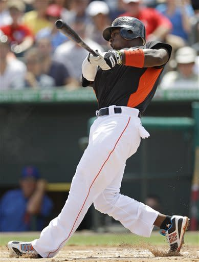 Miami Marlins' Hanley Ramirez hits a solo home run in the second inning of a spring training baseball game against the New York Mets in Jupiter, Fla., Saturday, March 31, 2012. (AP Photo/Patrick Semansky)
