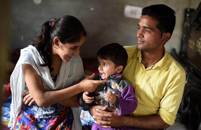 Tuberculosis patient Sonu Verma (R), 25, seen with his wife and child at their home in Sonipat, India