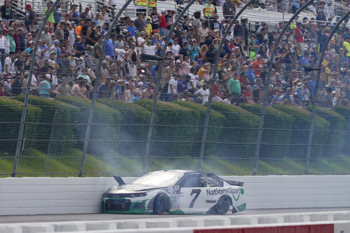 The car of Corey LaJoie (7) is smashed against the wall after crashing during a NASCAR Cup Series auto race at Pocono Raceway, Saturday, June 26, 2021, in Long Pond, Pa. (AP Photo/Matt Slocum)