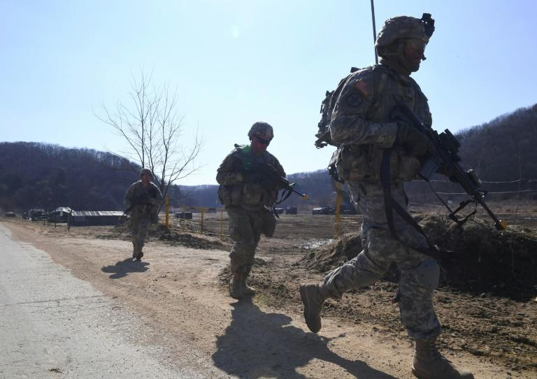 US soldiers patrol during their drill at a military training field in the border city of Paju on March 7, 2017