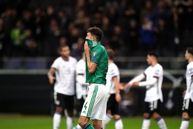 Tom Flanagan reacts after Julian Brandt makes it 6-1 to Germany