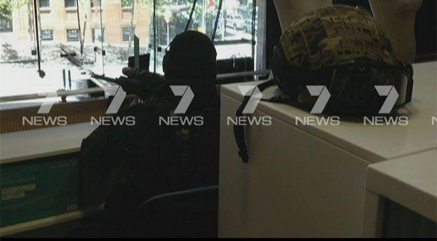 A sniper in the Seven Network newsroom, who had his sights trained on Man Haron Monis for hours. Photo: 7News