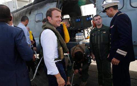 France's President Emmanuel Macron waits on the tarmac of Pointe-a-Pitre airport, Guadeloupe island, before boarding an helicopter en route to French Caribbean islands of St. Martin and St. Barthelemy - Credit: CHRISTOPHE ENA / POOL/ AP POOL
