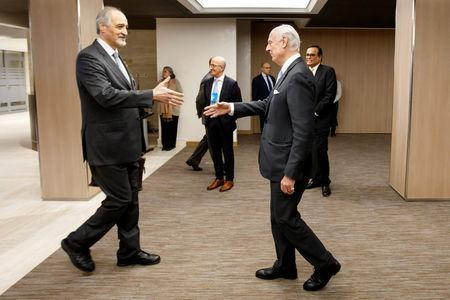 Bashar al-Jaafari shakes hands with UN Special Envoy of the Secretary-General for Syria Staffan de Mistura, right, prior a round of negotiation, during the Intra Syria talks, at the European headquarters of the United Nations in Geneva