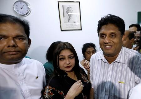 Premadasa, Sri Lanka's housing minister and deputy leader of ruling UNP and his wife Premadasa look on at the party office in Colombo