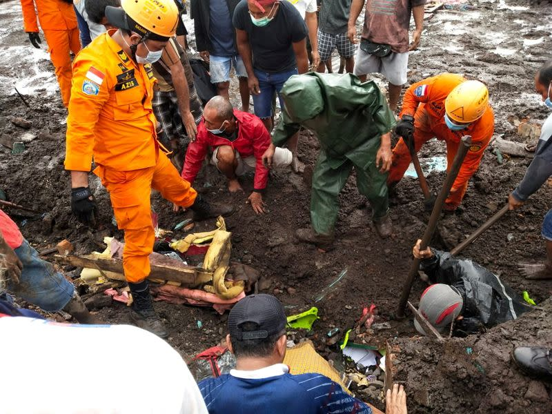 Indonesia rescue agency search for a body at an area affected by flash floods after heavy rains