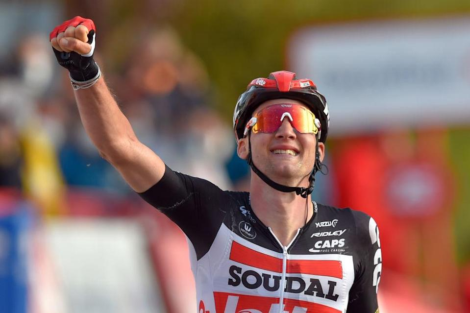 Team Lotto rider Belgiums Tim Wellens celebrates as he crosses the finishline of the 5th stage of the 2020 La Vuelta cycling tour of Spain a 1844km race from Huesca to Sabinanigo on October 24 2020 Photo by ANDER GILLENEA  AFP Photo by ANDER GILLENEAAFP via Getty Images
