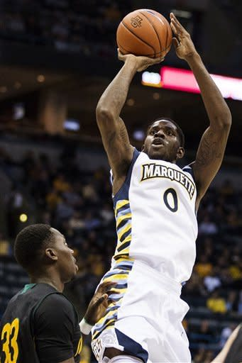 Marquette's Jamil Wilson (0) shoots over Southeastern Louisiana's Onochie Ochie (33) during the first half of their NCAA college basketball game, Tuesday, Nov. 13, 2012, in Milwaukee. (AP Photo/Tom Lynn)