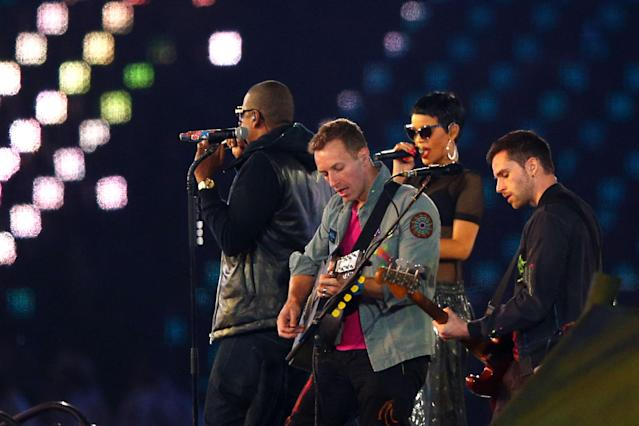 LONDON, ENGLAND - SEPTEMBER 09: Rihanna, Jay-Z perform with Chris Martin and Guy Berryman of Coldplay during the closing ceremony on day 11 of the London 2012 Paralympic Games at Olympic Stadium on September 9, 2012 in London, England. (Photo by Hannah Johnston/Getty Images)