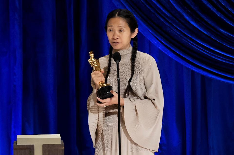 """Chloé Zhao accepts best director Oscar for """"Nomadland."""" She's the first woman of color to win the category."""