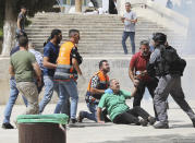 Israeli police clears Palestinians from the plaza in front of the Dome of the Rock shrine at al-Aqsa mosque complex in Jerusalem, Friday, May 21, 202, as aa cease-fire took effect between Hamas and Israel after 11-day war. (AP Photo/Mahmoud Illean)