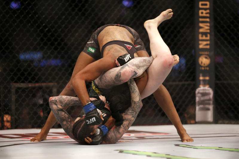 MELBOURNE, AUSTRALIA - OCTOBER 06: Megan Anderson of Australia and Zarah Fairn of France fight nin the Women's featherweight bout during UFC 243 at Marvel Stadium on October 06, 2019 in Melbourne, Australia. (Photo by Darrian Traynor/Getty Images)