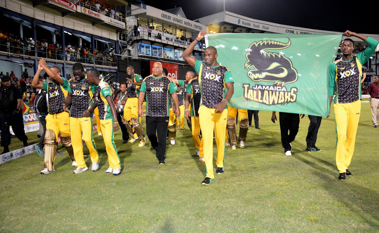 PORT OF SPAIN, TRINIDAD AND TOBAGO - AUGUST 24: The Jamaica Tallawahs celebrate victory during the Final of the Cricket Caribbean Premier League between Guyana Amazon Warriors v Jamaica Tallawahs at Queen's Park Oval on August 24, 2013 in Port of Spain, Trinidad and Tobago. (Photo by Lloyd Pierre/Getty Images Latin America for CPL)