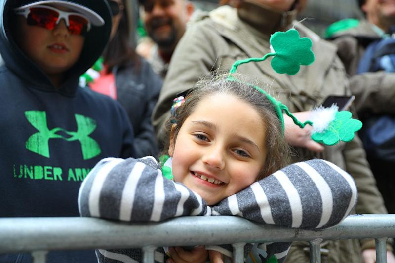 A youngster poses for a photo during a break in marching in the St. Patrick's Day Parade, March 16, 2019, in New York. (Photo: Gordon Donovan/Yahoo News)