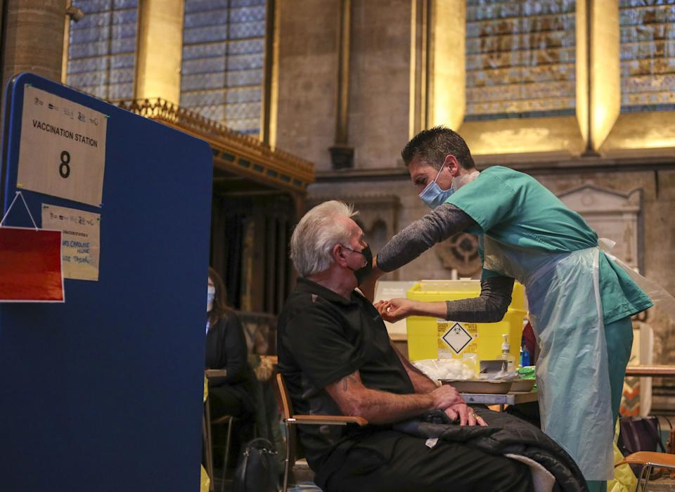Lynn Court receives an injection of the Pfizer coronavirus vaccine from Dr Ben Kay at Salisbury Cathedral, Wiltshire.PA