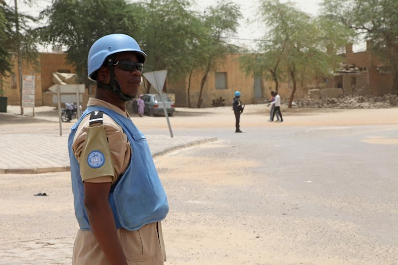 A UN peacekeeper of the Minusma stading guard on the Independence Square in Timbuktu (AFP Photo/Sebastien Rieussec)