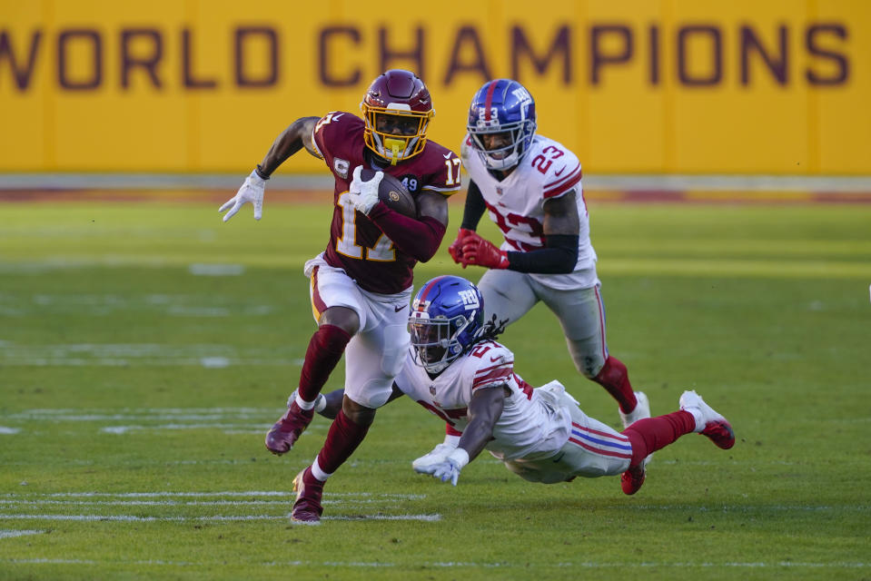 Washington Football Team wide receiver Terry McLaurin (17) runs past New York Giants cornerback Isaac Yiadom (27) and free safety Logan Ryan (23) to score a touchdown in the second half of an NFL football game between the New York Giants and Washington Football Team, Sunday, Nov. 8, 2020, in Landover, Md. (AP Photo/Susan Walsh)