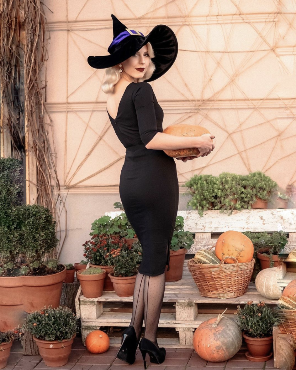 """<p>You can still go glam and dress as a witch. Channel vintage vibes with a sleek black dress, pumps, and a witch hat. </p><p><a class=""""link rapid-noclick-resp"""" href=""""https://www.amazon.com/elope-Ridged-Black-Witch-Velvet/dp/B00AQ6WMAE?tag=syn-yahoo-20&ascsubtag=%5Bartid%7C10072.g.33534666%5Bsrc%7Cyahoo-us"""" rel=""""nofollow noopener"""" target=""""_blank"""" data-ylk=""""slk:SHOP WITCH HAT"""">SHOP WITCH HAT</a></p><p><a class=""""link rapid-noclick-resp"""" href=""""https://www.amazon.com/Amazon-Brand-Womens-Sleeve-Center/dp/B07MKLJMRD?tag=syn-yahoo-20&ascsubtag=%5Bartid%7C10072.g.33534666%5Bsrc%7Cyahoo-us"""" rel=""""nofollow noopener"""" target=""""_blank"""" data-ylk=""""slk:SHOP DRESS"""">SHOP DRESS</a></p><p><a class=""""link rapid-noclick-resp"""" href=""""https://www.amazon.com/dp/B00LH02OWE?tag=syn-yahoo-20&ascsubtag=%5Bartid%7C10072.g.33534666%5Bsrc%7Cyahoo-us"""" rel=""""nofollow noopener"""" target=""""_blank"""" data-ylk=""""slk:SHOP BLACK STILETTOS"""">SHOP BLACK STILETTOS</a></p>"""