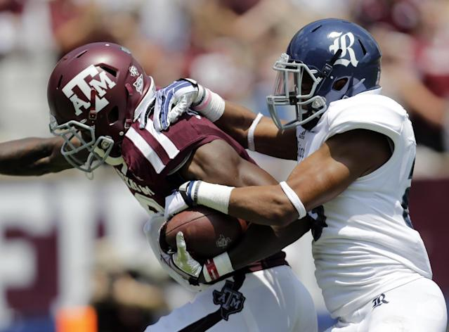 Texas A&M's Ricky Seals-Jones, left, pulls Rice defender Bryce Callahan, righ, across the goal line on a 71-yard touchdown during the second quarter of an NCAA college football game, Saturday, Aug. 31, 2013, in College Station, Texas. (AP Photo/Eric Gay)