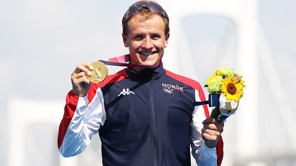 Kristian Blummenfelt, pictured here celebrating with the gold medal after winning the Olympics triathlon.