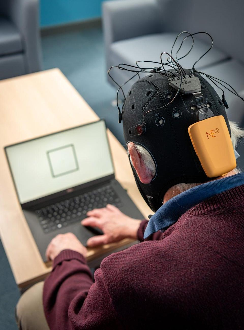Patients wear the wireless EEG cap and complete tasks on a laptop (Nic Delves Broughton/University of Bath/PA)