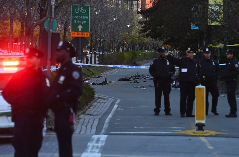 Police observe the aftermath of the New York attack (Picture: REX)