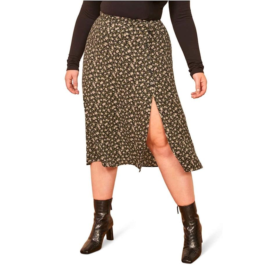 """Discounted Reformation? Yes please. Whether you layer it over <a href=""""https://www.glamour.com/gallery/patterned-black-tights?mbid=synd_yahoo_rss"""" target=""""_blank"""">black tights</a> or stow it away until spring, this floral <a href=""""https://www.glamour.com/story/best-leopard-print-midi-skirts?mbid=synd_yahoo_rss"""" target=""""_blank"""">midi skirt</a> is bound to become a style staple. $148, Nordstrom. <a href=""""https://shop.nordstrom.com/s/reformation-jaime-side-slit-skirt-plus-size/5433040/full"""">Get it now!</a>"""