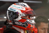 Ferrari driver Charles Leclerc of Monaco prepares for the first practice session at the Marina Bay City Circuit ahead of the Singapore Formula One Grand Prix in Singapore, Friday, Sept. 20, 2019. (AP Photo/Vincent Thian)