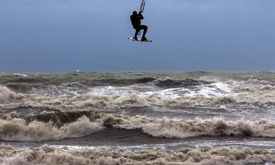 A kite-surfer kites the brave sea. Source: AAP/Stock image