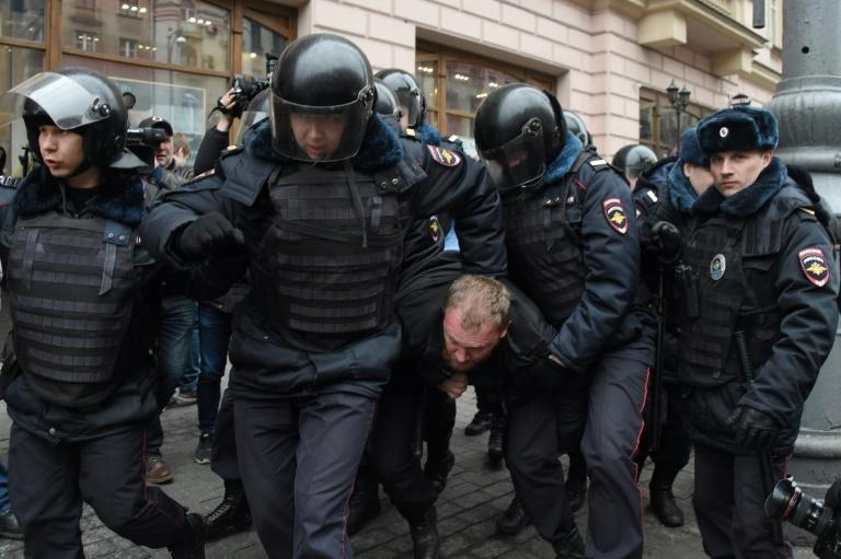 Russian police officers detain a man in central Moscow on April 2, 2017, as Russian opposition promised protests after police detained hundreds of people during anti-corruption rallies