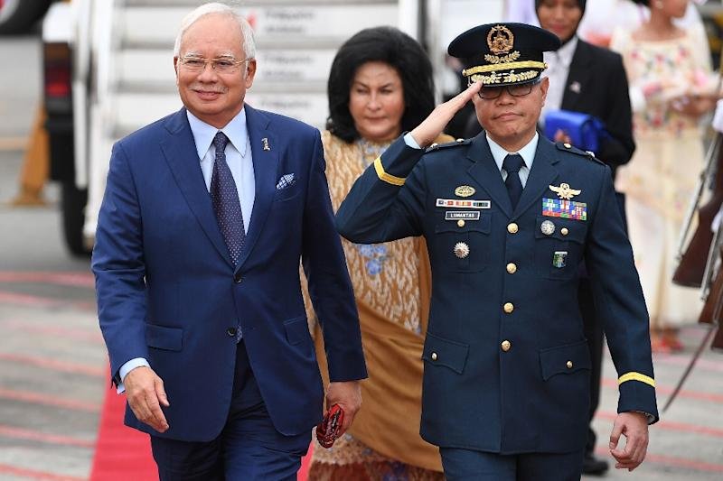 Malaysian Prime Minister Najib Razak (L) has long been accused of repressing dissent (AFP Photo/Mohd RASFAN)