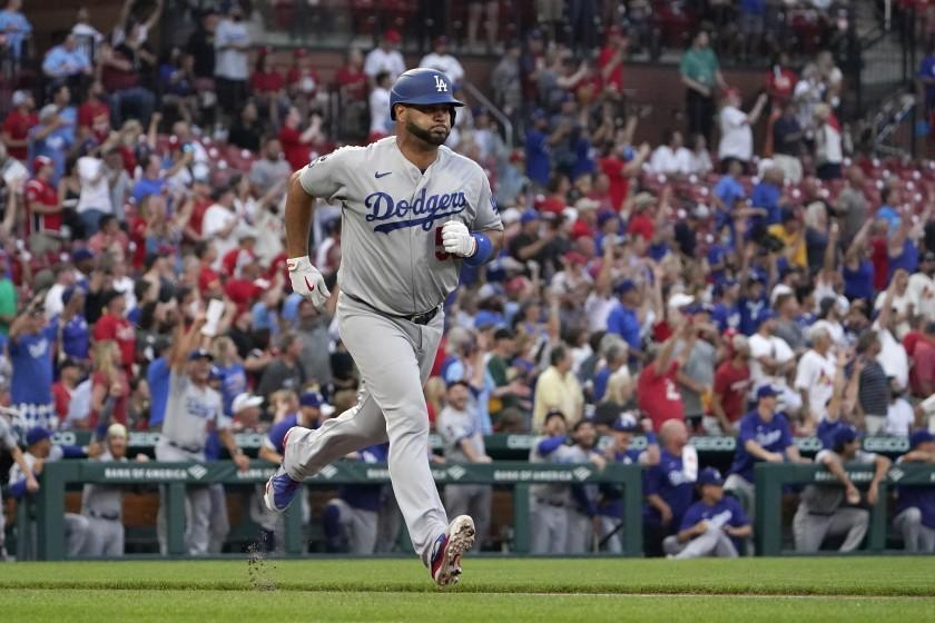 Los Angeles Dodgers' Albert Pujols rounds the bases after hitting a solo home run during the first inning of a baseball game against the St. Louis Cardinals Tuesday, Sept. 7, 2021, in St. Louis. (AP Photo/Jeff Roberson)