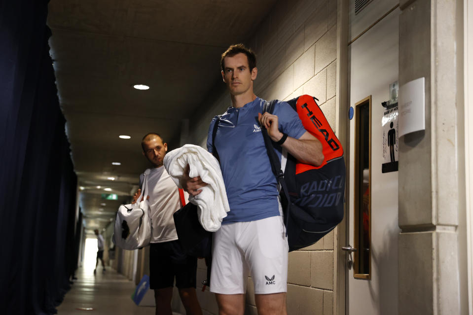 Andy Murray prepares to enter the court ahead of his singles semi final match.
