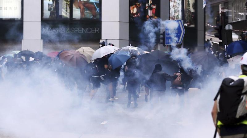 Protesters were hit by tear gas as they rallied in Hong Kong's financial district for a second day