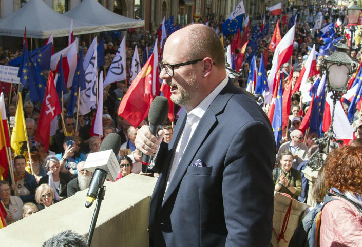 FILE - In this Saturday, April 21, 2018 file photo, the mayor of Gdansk, Pawel Adamowicz addresses a rally organized in protest against a recent gathering by far-right groups in this Baltic coast city, in Gdansk, Poland. A private broadcaster in Poland is reporting that a man attacked 53-year-old Mayor Pawel Adamowicz while he was on stage on Sunday Jan. 13, 2019, for the finale of the charity event in the Baltic city. (AP Photo/Wojciech Strozyk, File)