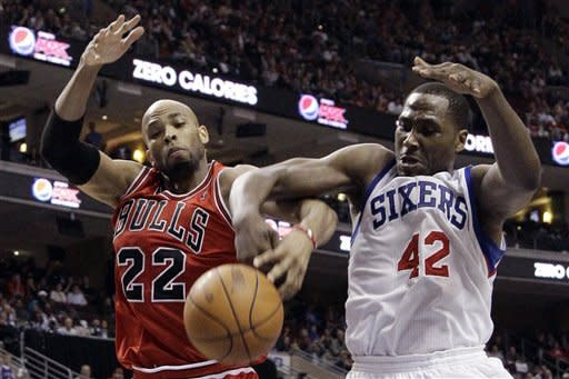 Chicago Bulls' Taj Gibson, left, and Philadelphia 76ers' Elton Brand battle for a rebound in the first half of Game 6 in an NBA basketball first-round playoff series on Thursday, May 10, 2012, in Philadelphia. (AP Photo/Matt Slocum)