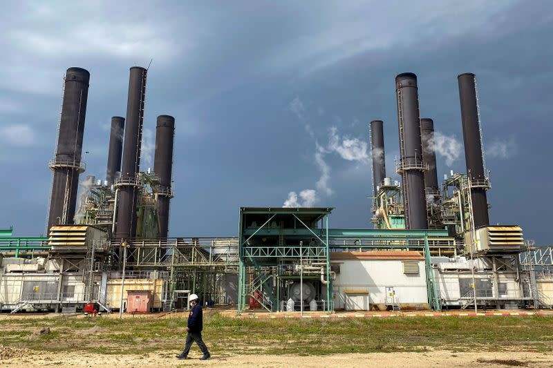 A member of the staff walks at Gaza's lone power plant, in the central Gaza Strip