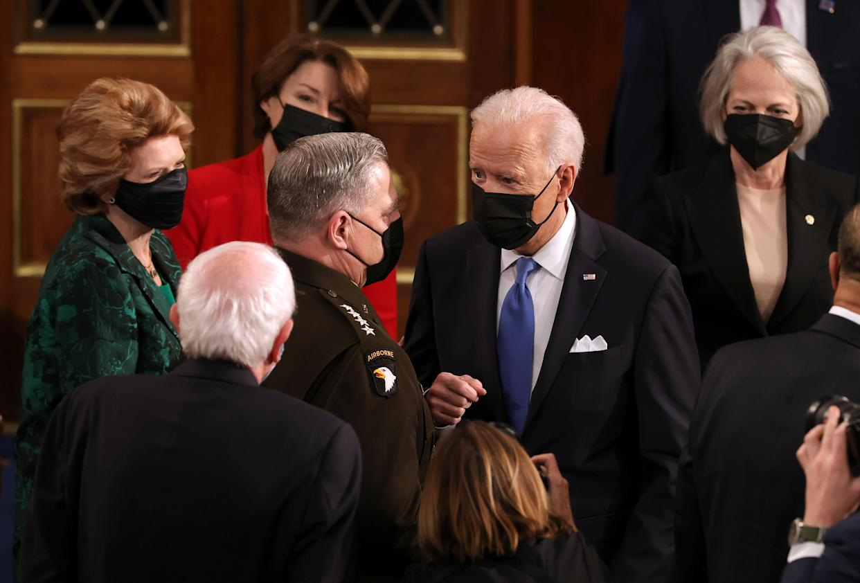 U.S. President Joe Biden speaks with Chairman of the Joint Chiefs of Staff Mark A. Milley (L) after addressing a joint session of congress in the House chamber of the U.S. Capitol April 28, 2021 in Washington, DC. (Chip Somodevilla/Getty Images)