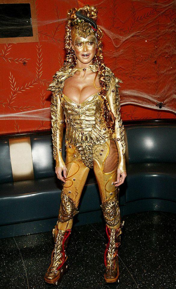 <p>No. 11: Klum was outta this world in 2003, slipping into an alien outfit. But she wasn't dressed as just any extraterrestrial — the supermodel was a glistening gold one, wearing body glitter galore, fake teeth, and crazy Medusa-like braids. To show just how committed she was to the costume, she even arrived in a UFO! (Photo: Evan Agostini/Getty Images) </p>