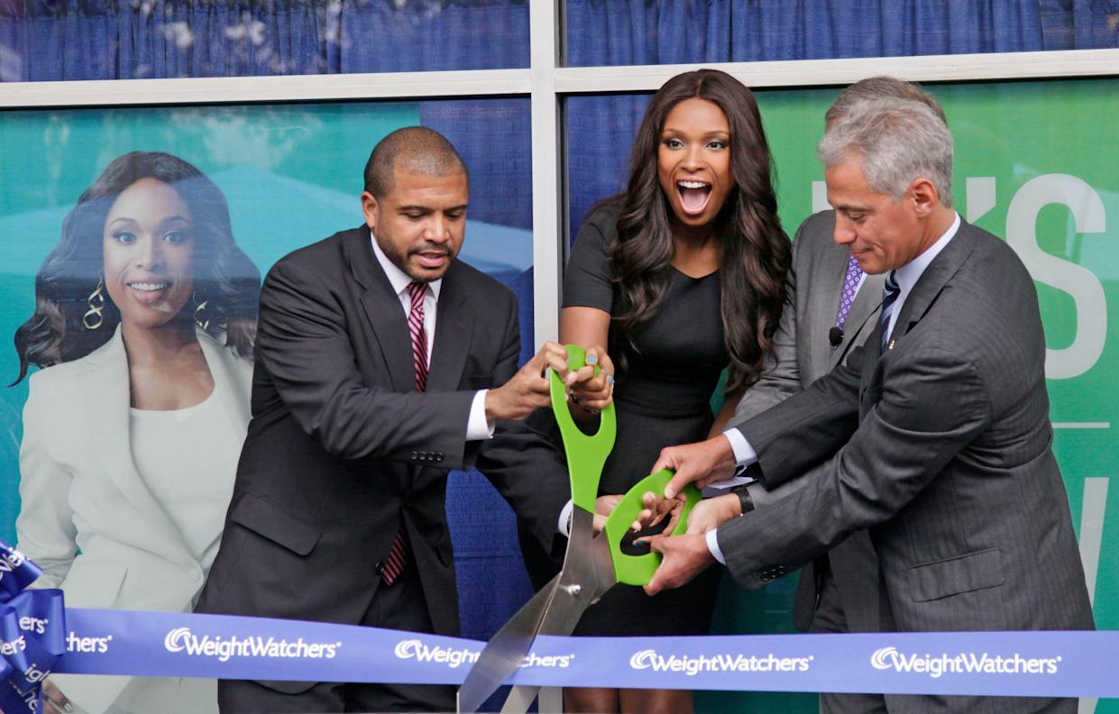 Chicago Alderman Will Burns, left, Grammy and Oscar-winning singer and actress Jennifer Hudson, Dave Burwick, President, Weight Watchers North America, and Chicago Mayor Rahm Emanuel take part in a ribbon cutting at the opening of