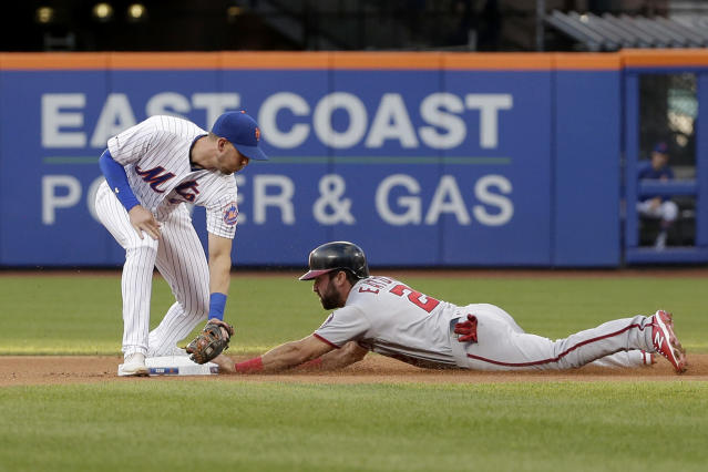 Washington Nationals' Adam Eaton, right, slides safely into second base against New York Mets second baseman Jeff McNeil during the first inning of a baseball game Saturday, Aug. 10, 2019, in New York. (AP Photo/Seth Wenig)
