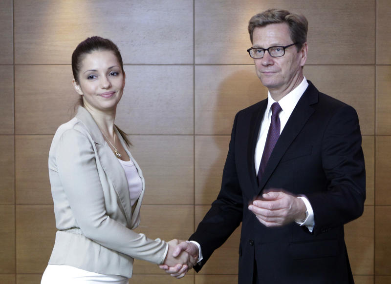 Eugenia Tymoshenko, daughter of jailed former Ukrainian Prime Minister Yulia Tymoshenko, meets with German Foreign Minister Guido Westerwelle in Kiev, Ukraine, Friday, June 21 2013. The party of Tymoshenko on Friday asked Westerwelle in assisting in sending Tymoshenko to Germany for medical assistance. (AP Photo/Sergei Chuzavkov)
