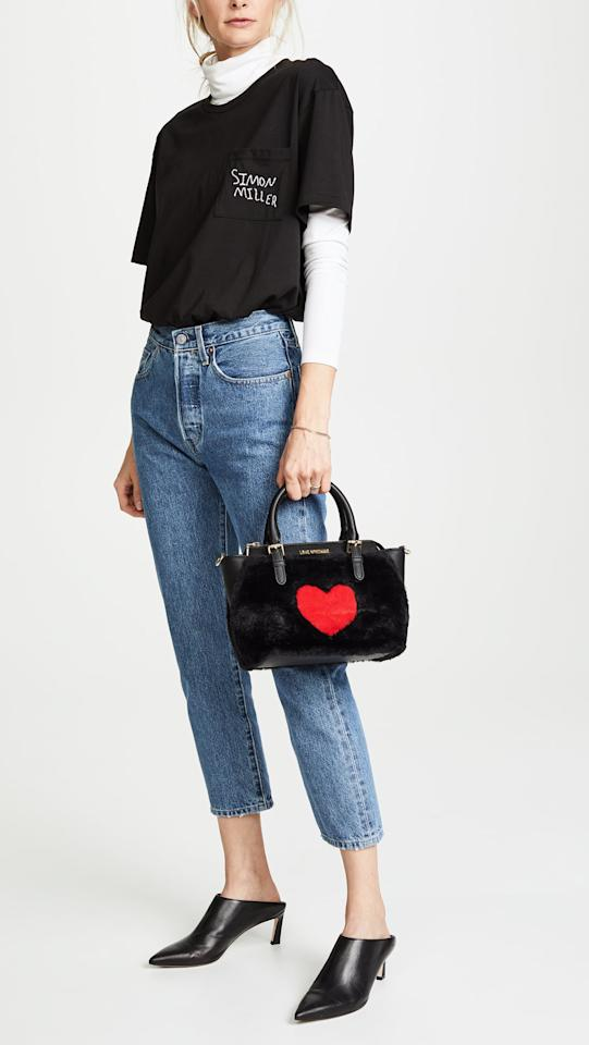 """<p>This adorable <a rel=""""nofollow"""" href=""""https://www.popsugar.com/buy/Moschino-Love-Moschino-Top-Handle-Tote-363851?p_name=Moschino%20Love%20Moschino%20Top%20Handle%20Tote&retailer=shopbop.com&price=220&evar1=fab%3Aus&evar9=45248724&evar98=https%3A%2F%2Fwww.popsugar.com%2Ffashion%2Fphoto-gallery%2F45248724%2Fimage%2F45248736%2FMoschino-Love-Moschino-Top-Handle-Tote&list1=shopping%2Cfall%20fashion%2Caccessories%2Cbags%2Cfall%2Cwinter%2Cwinter%20fashion&prop13=desktop&pdata=1"""" rel=""""nofollow"""">Moschino Love Moschino Top Handle Tote</a> ($220) is melting our hearts.</p>"""